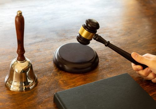 Judge hitting a gavel on wooden desk background. .